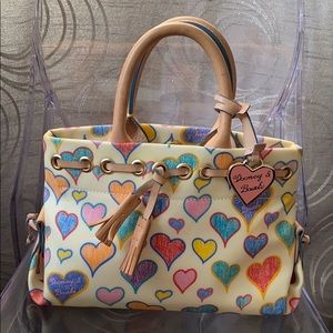 DOONEY AND BOURKE TASSEL HEART BAG US PAT# 5722126
